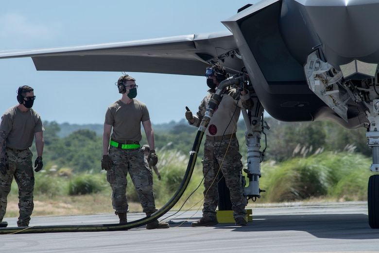 U.S. Air Force Airmen perform hot-pit refueling on an F-35A Lightning II assigned to Eielson Air Force Base, Alaska, at Northwest Field as part of Agile Combat Employment (ACE) multi-capable Airmen training during Cope North 21 at Andersen AFB, Guam, Feb. 16, 2021.