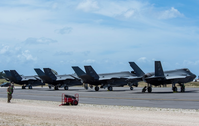 Four F-35A Lightning II assigned to Eielson Air Force Base, Alaska, sit at Northwest Field after participating in hot-pit refueling as part of Agile Combat Employment (ACE) multi-capable Airmen training during Cope North 21 at Andersen AFB, Guam, Feb. 16, 2021.