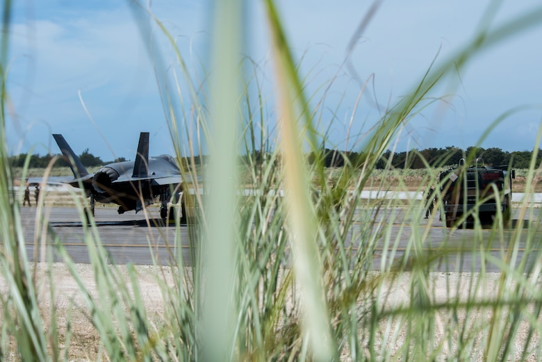 An F-35A Lightning II assigned to Eielson Air Force Base, Alaska, awaits to refuel from an R-11 fuel truck at Northwest Field as part of Agile Combat Employment (ACE) multi-capable Airmen training during Cope North 21 at Andersen AFB, Guam, Feb. 16, 2021.