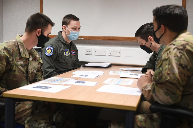 A Tanker Heist team of aircrew members receives a pre-mission brief prior to their turn in the KC-135 Stratotanker aircraft flight simulator at Royal Air Force Mildenhall, England, Feb. 11, 2021. During this time, each team determined how best to execute maneuvers in accordance with KC-135 manuals and directives and Air Force tactics, techniques and procedures. (U.S. Air Force photo by Staff Sgt. Mackenzie Mendez)