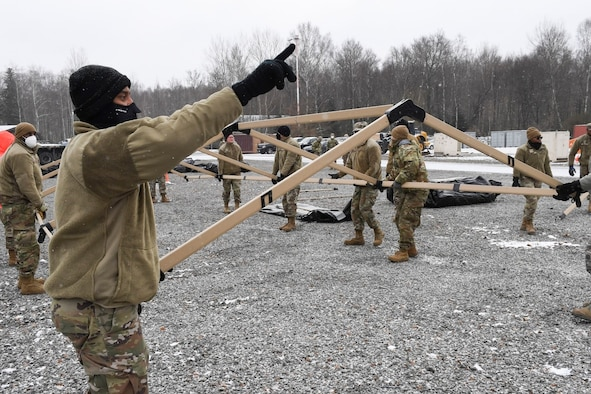 Members of the 52nd Civil Engineer Squadron from Spangdahlem Air Base, Germany, construct a tent at Ramstein Air Base, Germany, Feb. 10, 2021.