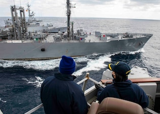 USS Curtis Wilbur (DDG 54) conducts a replenishment-at-sea.