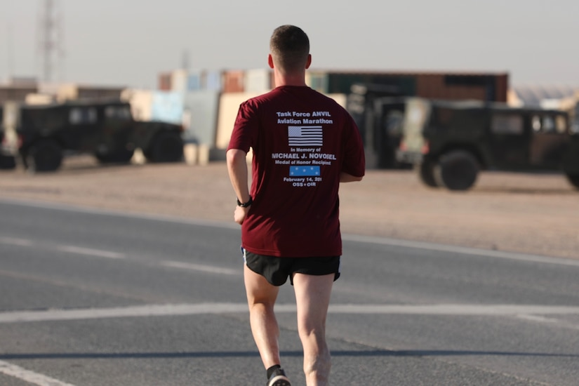 U.S. Army Capt. Matthew Stern, logistics officer with Headquarters Support Company, 628th Aviation Support Battalion, 28th Expeditionary Combat Aviation Brigade, runs during the Task Force Anvil Marathon. About 120 Soldiers raced in memory of Michael J. Novosel, Sr., a native of Etna, Pennsylvania, who served for over 40 years as an Army aviator and received the Medal of Honor for rescuing 29 Soldiers during the Vietnam War.