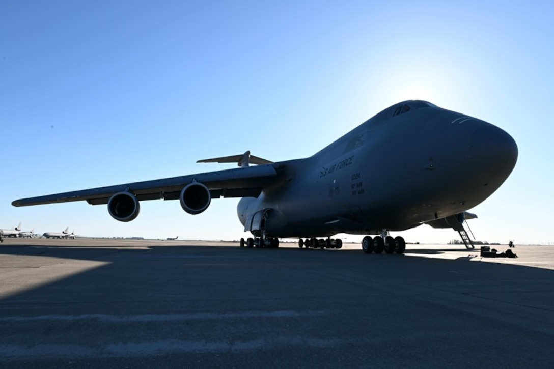 A C-5M Super Galaxy is parked on a flight line