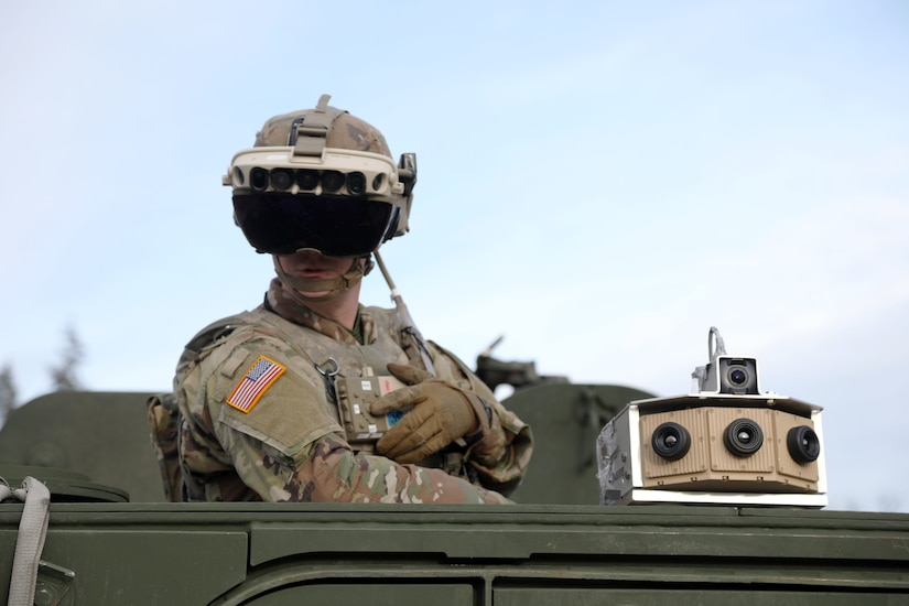 Soldier dons the Integrated Visual Augmentation System Capability Set 3 hardware while mounted on a Stryker in Joint Base Lewis-McCord, WA.