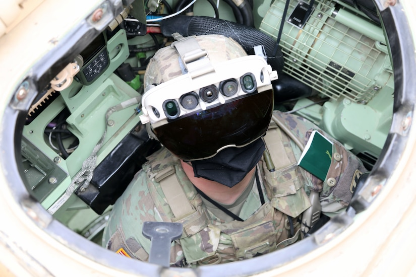 Soldier dons the Integrated Visual Augmentation System Capability Set 3 hardware while mounted on a Bradley in Joint Base Lewis-McCord, WA.