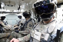 Soldiers don the Integrated Visual Augmentation System Capability Set 3 hardware while mounted in a Stryker in Joint Base Lewis-McCord, WA.