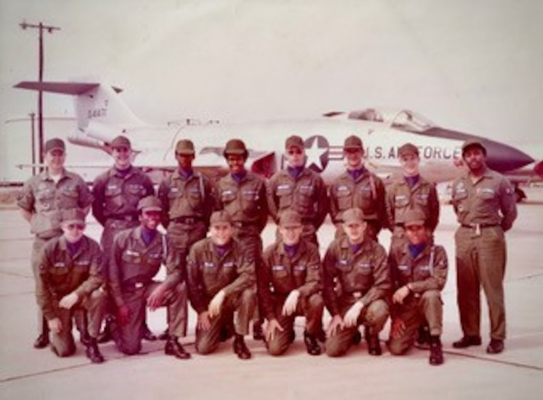 Former Airman Galen Williams, top row, center left, poses for a photo in front of a F-101 Voodoo after graduating technical training at Sheppard Air Force Base, Texas, 1973. Williams retired from the Air Force as a master sergeant in 1995 and went on to serve as the Safety director at Hanscom Air Force Base, Mass. Williams will retire Feb. 27 after 46 combined years of military and federal service. (Courtesy Photo).