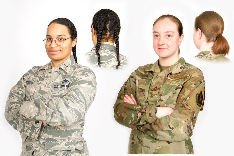 2nd Lt. Julia Person, 434th Operations Support Squadron intelligence officer, left, and Tech Sgt. Sara Becker, 434th Aircraft Maintenance Squadron avionics specialist, pose for a photo at Grissom Air Reserve Base, Indiana Feb. 15, 2021 to demonstrate how they are wearing their hair with the newly implemented Air Force hair regulations for woman. Women are now able to wear their hair in up to two braids or a single ponytail with bulk not exceeding the width of the head and length not extending below a horizontal line running between the top of each sleeve inseam at the underarm through the shoulder blades. (U.S. Air Force graphic/Master Sgt. Ben Mota)
