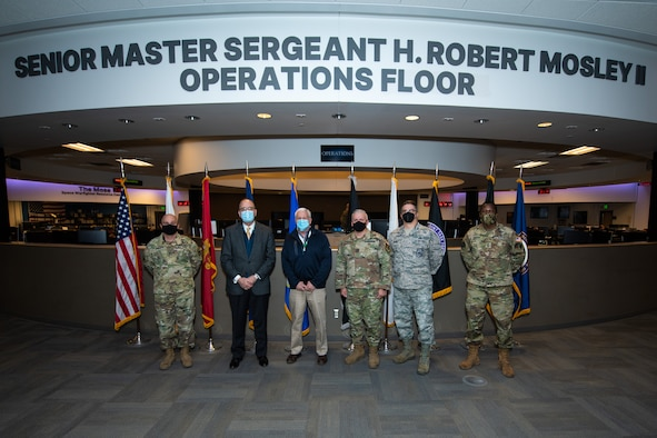 Senior leaders gather on the National Space Defense Center operations floor during a visit to learn more about the organization's mission.