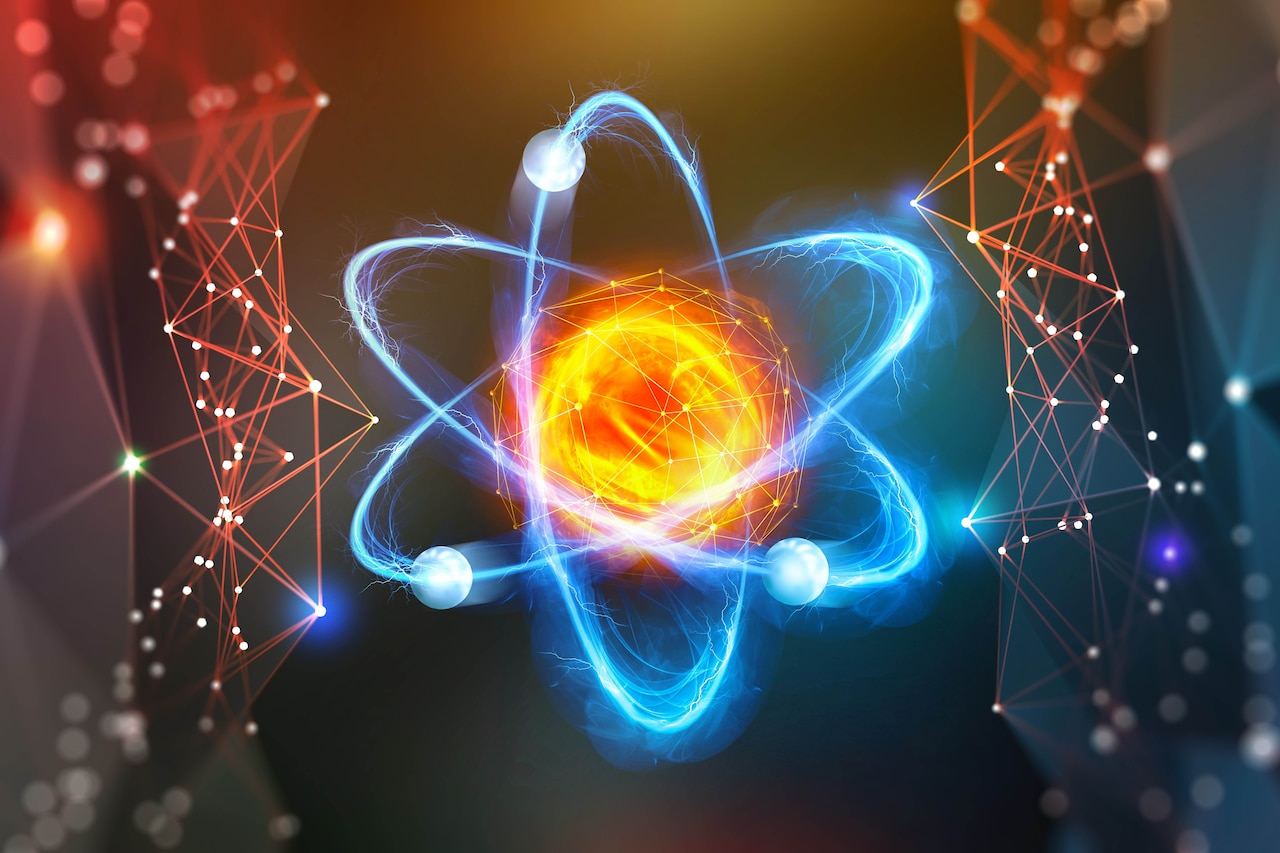 A graphic depicts an atom.