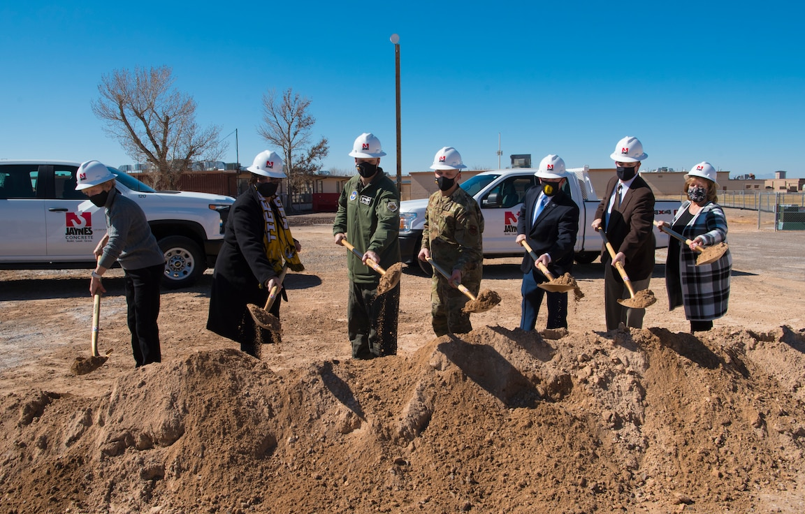 49th Wing leadership and Alamogordo Public School District leadership pose for a photo during the groundbreaking for new school construction, Feb. 19, 2021, on Holloman Air Force Base, New Mexico. The architectural design for the new Holloman Elementary School includes structures that will resemble an air traffic control tower, F-16 Viper contrail, and the roof will resemble aircraft wings. (U.S. Air Force photo by Airman 1st Class Jessica Sanchez)