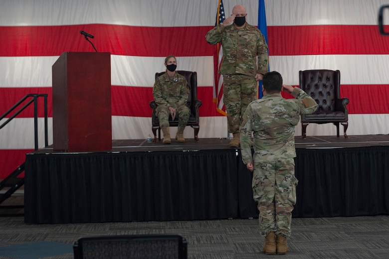 Photo of an Airman saluting the new 23d HCOS commander