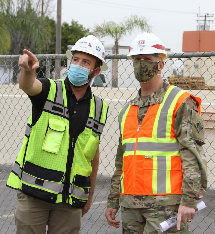 Luke Halpin, construction manager with Layton Construction Company, left, talks with Brig. Gen. Paul Owen, U.S. Army Corps of Engineers South Pacific Division commander, during Owen's Feb. 9 visit to Beverly Community Hospital in Montebello, California, to see construction progress there, including upgrades to a 17-bed wing in the facility for non-COVID patients and the conversion of a pre-operation waiting room to a COVID staging area through the addition of high-flow oxygen.