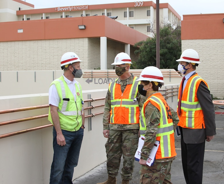 Martin Reed, contracting officer's representative with the U.S. Army Corps of Engineers Rapid Response Technical Center of Expertise at the Omaha District, left, provides project updates to Brig. Gen. Paul Owen, U.S. Army Corps of Engineers South Pacific Division commander, center, during Owen's Feb. 9 visit to Beverly Community Hospital in Montebello, California. Accompanying Owen were Col. Julie Balten, Los Angeles District commander, second from right, and David Van Dorpe, LA District deputy engineer.