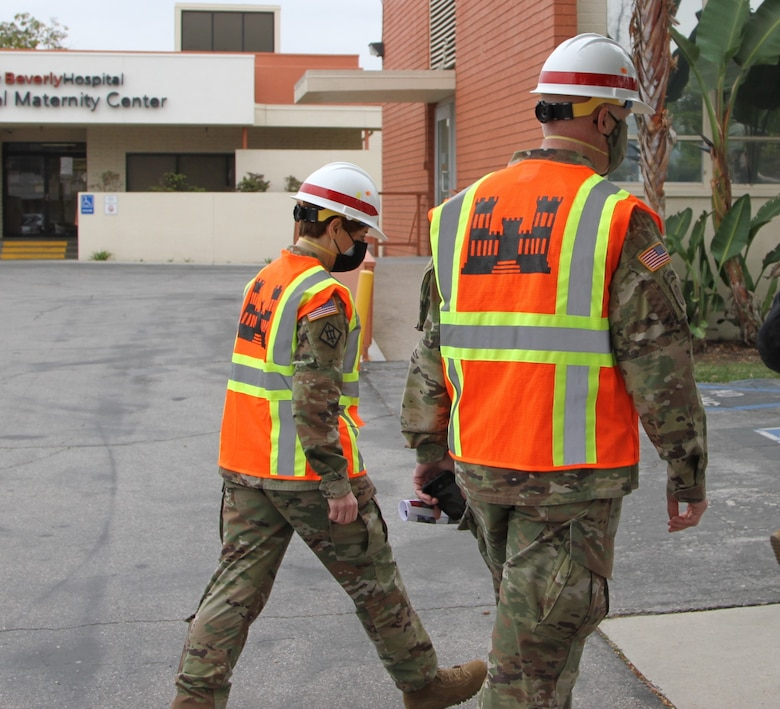 Col. Julie Balten, U.S. Army Corps of Engineers Los Angeles District commander, left, talks with Brig. Gen. Paul Owen, U.S. Army Corps of Engineers South Pacific Division commander, during Owen's Feb. 9 walk-through of Beverly Community Hospital to review early construction progress at the facility, including upgrades to a 17-bed wing in the facility for non-COVID patients and the conversion of a pre-operation waiting room to a COVID staging area through the addition of high-flow oxygen.