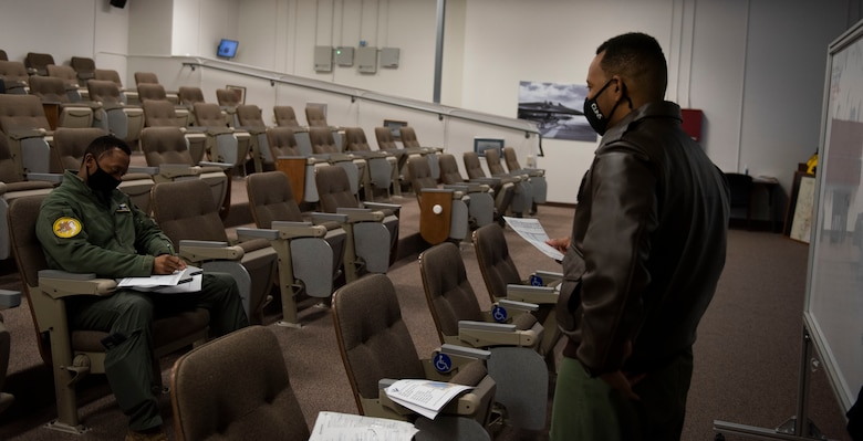 Capt. Michael Craig, left, 311th Fighter Squadron instructor pilot, listens to a pre-flight brief from Capt. Andre Golson, 8th FS IP, Feb. 18, 2021, on Holloman Air Force Base, N.M. In recognition of Black History Month, Craig and Golson teamed up with black pilots from McChord Air Force Base and Fairchild AFB, Washington, to form an all-Black crew during a flight in the local area. (U.S. Air Force photo by Airman 1st Class Quion Lowe)