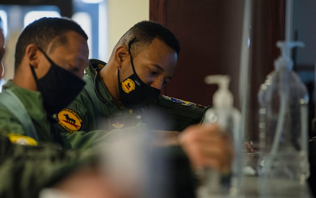 Capt. Michael Craig, left, 311th Fighter Squadron instructor pilot, and Capt. Andre Golson, right, 8th FS IP, are briefed at the step-desk, Feb. 18, 2021, on Holloman Air Force Base, N.M. Two 49th Wing F-16 Viper pilots participated in an all-Black aircrew fly-in. (U.S. Air Force photo by Airman 1st Class Quion Lowe)