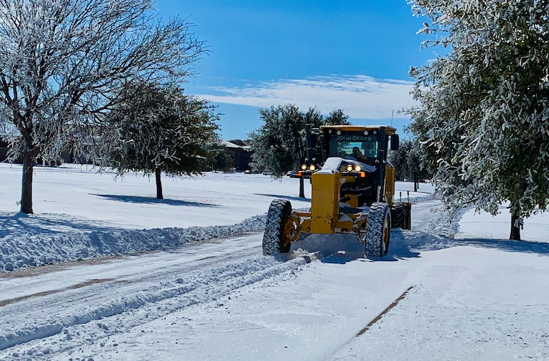 A member of the 17th Civil Engineering Squadron plows the streets throughout Goodfellow Air Force Base, Texas, Feb. 15, 2021. The 17th CES stood up a nine-man team and pieced together every available resource from around the base to tackle the issue of snow removal. (Courtesy photo)