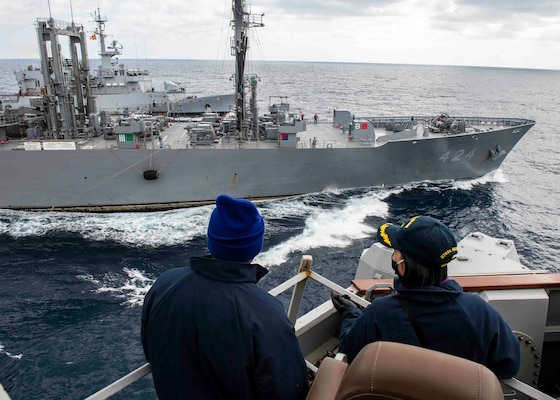 USS Curtis Wilbur (DDG 54) conducts a replenishment-at-sea with the Japan Maritime Self-Defense Force.
