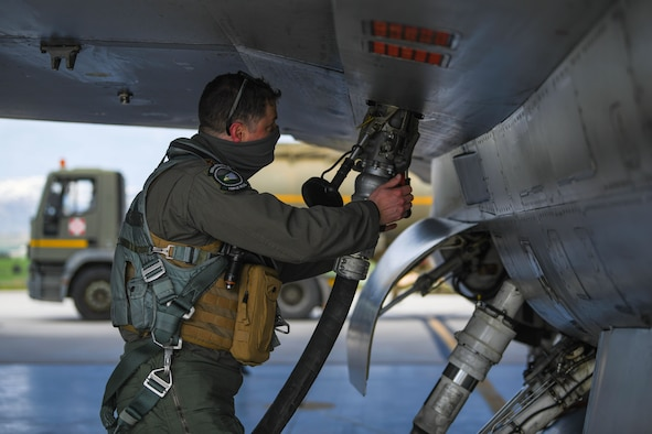 U.S. Air Force Maj. Mike Rogers, 555th Fighter Squadron pilot, refuels an F-16 Fighting Falcon during an Agile Combat Employment exercise at Amendola Air Base, Italy, Feb. 16, 2021. The exercise was designed to provide aircrew and support personnel the experience needed to maintain a ready force. (U.S. Air Force photo by Senior Airman Ericka A. Woolever)