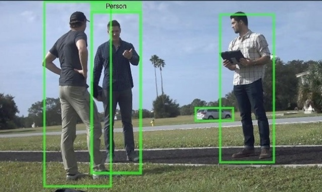 nduril's autonomous, unattended ground sensor, Dust, using computer vision, detected and classified, pictured here with (left to right) Anduril's Jackson Holahan and Kurt Freshley, and EWI Fellow 1st. Lt. Steven Groenheim.