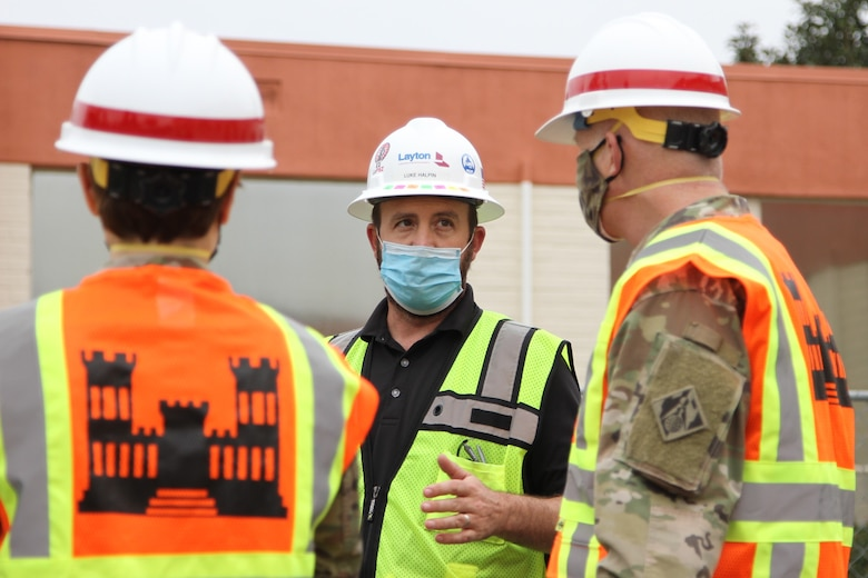 Luke Halpin, construction manager with Layton Construction Company, center, talks with Brig. Gen. Paul Owen, U.S. Army Corps of Engineers South Pacific Division commander, right, during Owen's Feb. 9 visit to Beverly Community Hospital in Montebello, California, to see construction progress there, including upgrades to a 17-bed wing in the facility for non-COVID patients and the conversion of a pre-operation waiting room to a COVID staging area through the addition of high-flow oxygen. At left is Col. Julie Balten, Los Angeles District commander.
