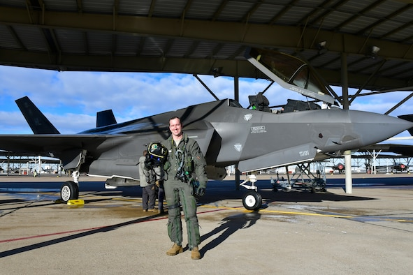 Maj. Daniel Toftness, an Air Force Reserve pilot in the 419th Fighter Wing at Hill Air Force Base, Utah, poses for a photo before for a flight Feb. 18 when he will reach 1,000 flying hours in the F-3A5 Lightning II.