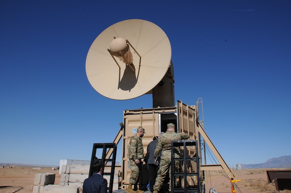 Military members tour and view directed energy technology