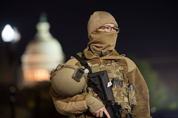 A security forces Airman stands guard at the U.S. Capitol Building in Washington D.C.