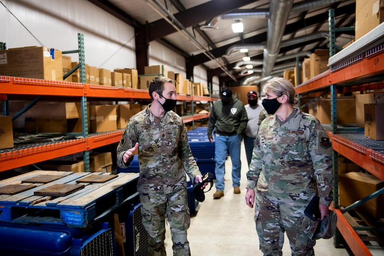 U.S. Air Force Brig. Gen. Caroline Miller (right), 502nd Air Base Wing and Joint Base San Antonio commander, receives a tour from Maj. Tate Grogan (left), 341st Training Squadron director of operations, of where K-9 were stored during the cold weather Feb. 19, 2021, at Joint Base San Antonio, Texas.