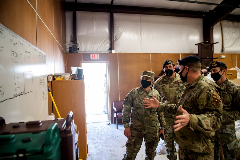 U.S. Air Force Brig. Gen. Caroline Miller (left), 502nd Air Base Wing and Joint Base San Antonio commander, receives a tour from Lt. Col. Mathew Kowalski (right), 341st Training Squadron commander, of where K-9 were stored during the cold weather Feb. 19, 2021, at Joint Base San Antonio, Texas.