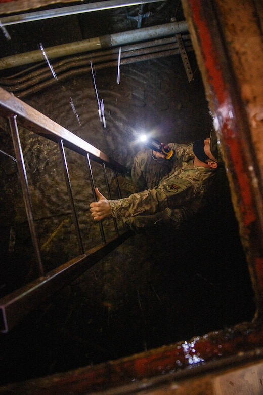 U.S. Air Force Master Sgt. Derek Hunter, 668th Alteration and Installation Squadron heating, ventilation, and air condition technician, reports damages caused by the severe winter storm lasting over five days, Feb. 19, 2021, at Joint Base San Antonio-Lackland, Texas.