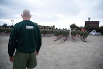 The 19th Sergeant Major of the Marine Corps, Sgt. Maj. Troy E. Black, observes the initial fitness test of the first gender integrated company at Marine Corps Recruit Depot San Diego, Ca, Feb. 12, 2021. The Sergeant Major of the Marine Corps conducted the visit to observe the integrated training and to speak to Depot staff. The Depot's primary function is to take quality young men and women from the western two-thirds of the United States and transform them through the foundations of rigorous basic training, our shared legacy, and a commitment to our Core Values, preparing them to win our Nation's battles in service to the country. (U.S. Marine Corps photo by Sgt. Victoria Ross)