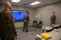 The 19th Sergeant Major of the Marine Corps, Sgt. Maj. Troy E. Black, tours the Center for Naval Aviation Technical Training (CNATT) at Marine Corps Air Station Cherry Point, Nc, Feb. 17, 2021. The Sergeant Major of the Marine Corps conducted the visit to look at the live virtual constructive training implemented at CNATT. The CNATT mission is to develop, deliver, and support aviation training necessary to meet validated fleet requirements through a continuum of professional and personal growth for Sailors and Marines. (U.S. Marine Corps photo by Sgt. Victoria Ross)