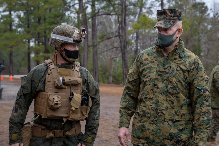 The 19th Sergeant Major of the Marine Corps, Sgt. Maj. Troy E. Black, observes Marines executing a live-fire range as part of the Basic Infantry Marine Course at Marine Corps Base Camp Lejeune, Nc, Feb. 18, 2021. The Sergeant Major of the Marine Corps conducted the visit to see how the current period of instruction is being taught at School of Infantry East. The mission of Infantry Training Battalion is to train and qualify Marines in entry-level infantry military occupational specialties in order to provide the Operating Forces and Reserve Component with Marines capable of conducting expeditionary combat operations. (U.S. Marine Corps photo by Sgt. Victoria Ross)