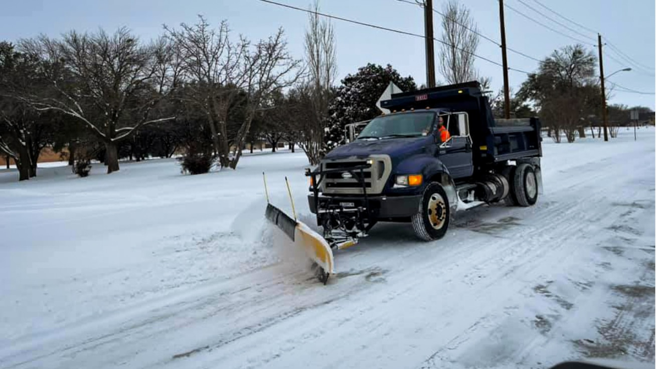 An 82nd Civil Engineer Squadron snowplow makes its way through snow-packed streets at Sheppard Air Force Base, Texas, Feb. 18, 2021. A winter weather event dumped almost a foot of snow on Sheppard AFB and throughout the North Texas and Southern Oklahoma region, more than two times the normal annual snowfall amount. (U.S. Air Force photo by Brig. Gen. Kenyon Bell)
