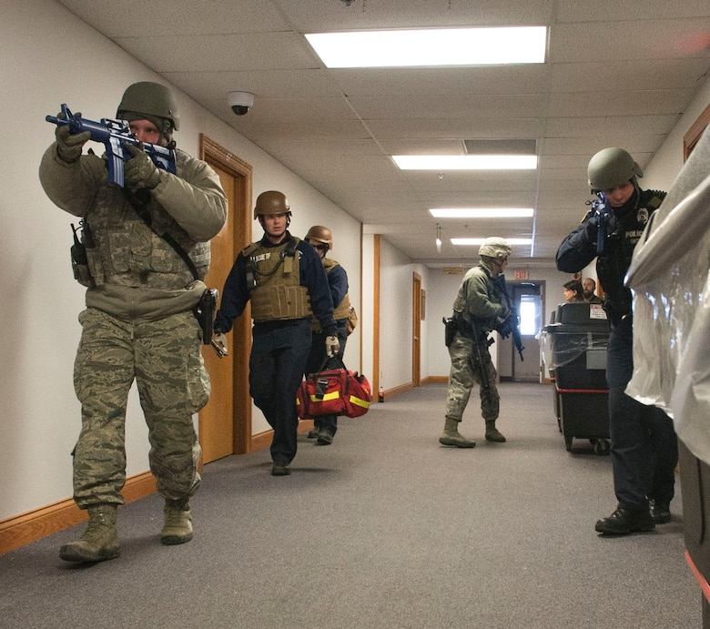 Wright-Patterson AFB Security Forces and emergency-response personnel enter a base facility during a February 2015 active-shooter exercise. Active-shooter response is the focus of a base-wide exercise Feb. 24. (U.S. Air Force photo/Wesley Farnsworth)