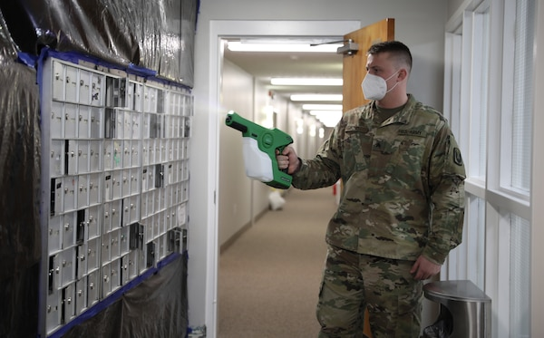 Spc. Quinton Boyd, assigned to a Facility Assistance Support Team, Kentucky National Guard, sanitizes mailboxes with an electrostatic sprayer at Sayre Christian Village, Lexington, Ky., Feb. 3, 2021. Gov. Andy Beshear directed troops to supplement long-term health care facilities in COVID-19 hot spots throughout Kentucky.