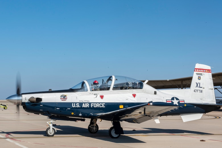 Maj. Gen. William Spangenthal, Air Education and Training Command deputy commander, steps to his T-6A Texan II for a training sortie at Laughlin Air Force Base, Texas, Feb. 9, 2021. The T-6 is the first aircraft student pilots fly, before specializing in either the T-1 Jayhawk or the T-38C Talon. (U.S. Air Force photo by Airman 1st Class David Phaff)