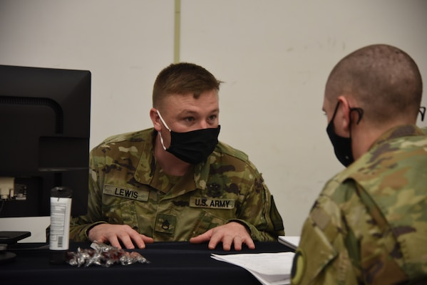 Virginia National Guard Soldiers assigned to the Recruiting and Retention Battalion talk to Soldiers about retention as they out-process following their support to law enforcement in Washington, D.C., Jan. 25, 2021, at Fort Pickett, Virginia. (U.S. Army National Guard photo by Sg. 1st Class Terra C. Gatti)