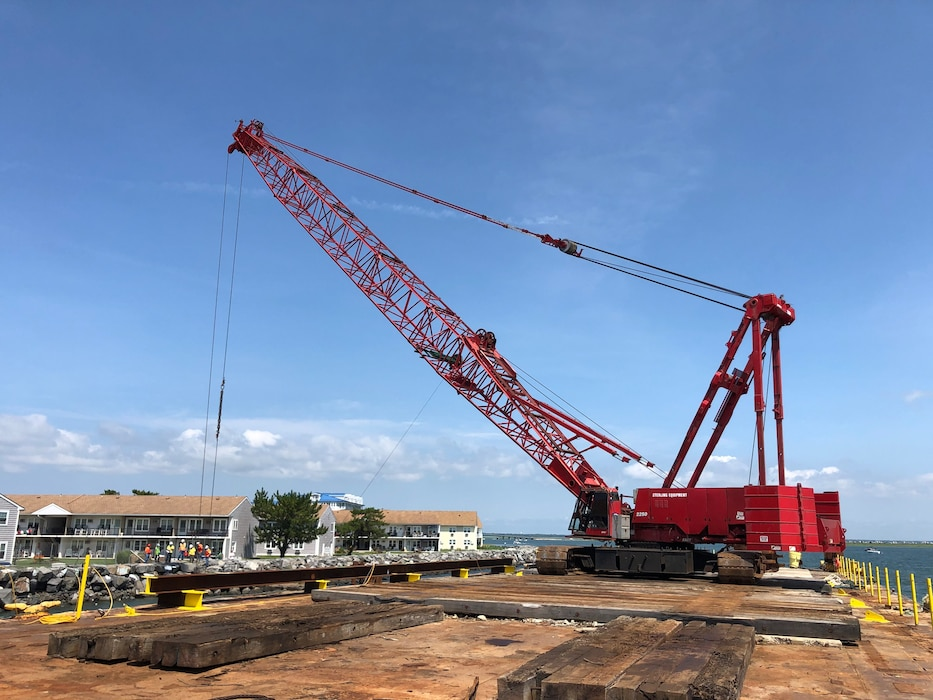 Crane moves equipment into place along a seawall in North Wildwood, NJ