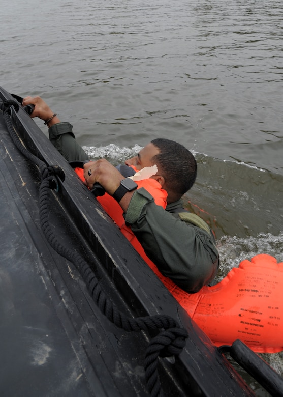 Technical Sgt. Christopher Adams, 908th Operations Support Squadron loadmaster, dives into the Alabama River Nov. 8, 2020, at Maxwell Air Force Base, Alabama.
