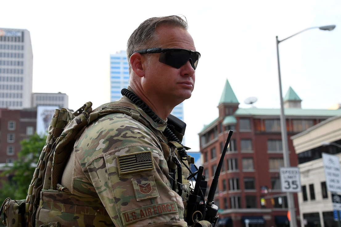 Tech. Sgt. Jack Shaw, a defender assigned to the 178th Security Forces Squadron, monitors operations June 5, 2020, in downtown Columbus, Ohio. About 25 members from the 178th SFS were activated to support Operation Guardian Serenity III, with Ohio National Guard personnel augmenting local law enforcement to provide safety and protection to community members during protests in Columbus and Cleveland. (U.S. Air National Guard photo by Staff Sgt. Amber Mullen)