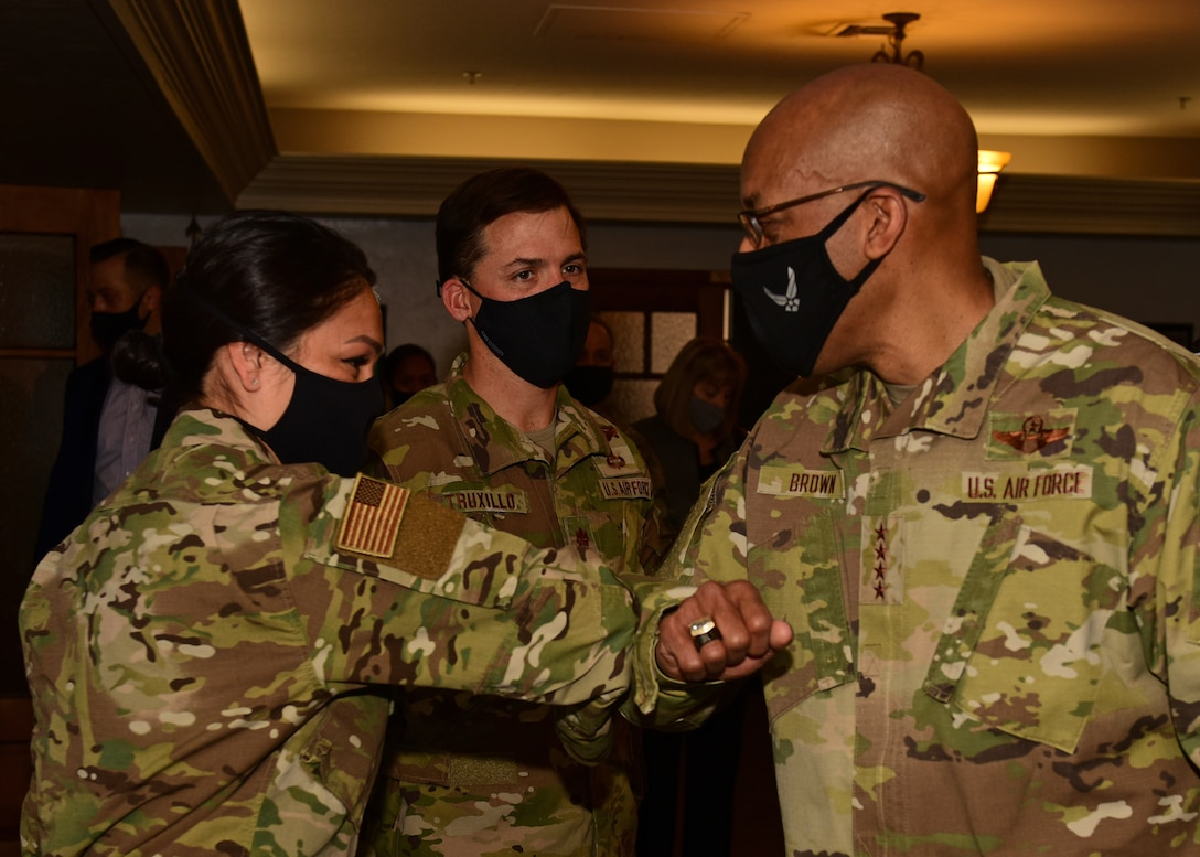 Air Force Chief of Staff Gen. Brown bumps elbows with an Airmen at Davis-Monthan AFB