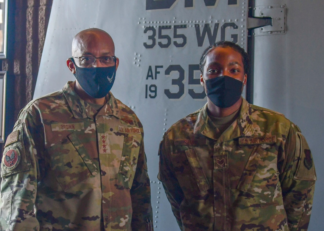 Air Force Chief of Staff, Gen. Charles Q. Brown poses for a photo with Staff Sergeant Giovanni Sims