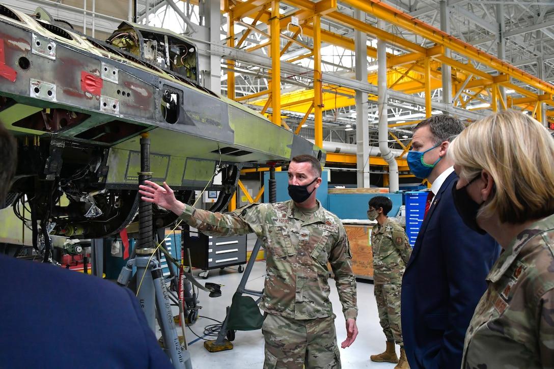 Col. Chris Boring (center), 309th Aircraft Maintenance Group commander, Utah Rep. Blake Moore and Hill leadership about F-16 aircraft maintenance during a visit to Hill Air Force Base, Utah, Feb. 16, 2021.