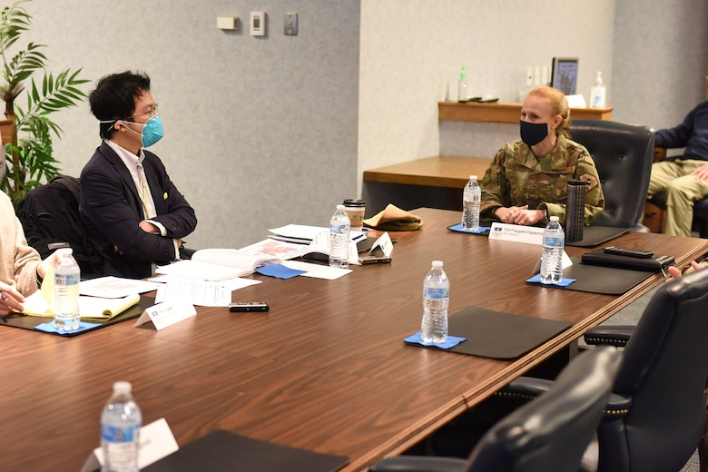 Mr. Takashi Watanabe and Col. Anita Feugate Opperman, 341st Missile Wing commander, sit at a table and discuess the mission brief before the media tour is conducted.
