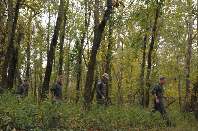 Members of the 908th Operations Group walk through the woods Nov. 8, 2020, at Maxwell Air Force Base, Alabama.