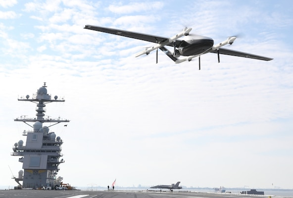 A logistics unmanned air system (UAS) prototype delivers cargo to USS Gerald R. Ford (CVN 78).